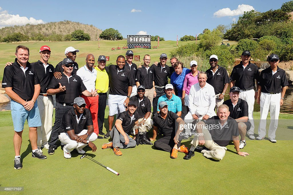 Gary Player and players of Team Player, Team Goosen, Team Fasth, Team Johnstone, Team Woods and Team Levet pose during the prizegivingh ceremony for the Gary Player Invitational presented by Coca-Cola at The Lost City Golf Course on November 17, 2013 in Sun City, South Africa.