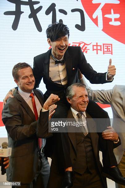 Gary Player carries singer JJ Lin on his shoulder during Gary Player Invitational Charity Dinner at ShangriLa Hotel on November 4 2013 in Shanghai...