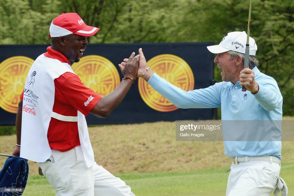 Gary Player (R) celebrates sinking a putt with his caddie during the Pro-Am of the Gary Player Invitational presented by Coca-Cola at The Lost City Golf Course on November 15, 2013 in Sun City, South Africa.