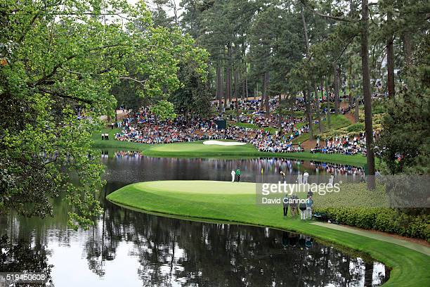 Gary Player Jack Nicklaus and Tom Watson of the United States putt during the Par 3 Contest prior to the start of the 2016 Masters Tournament at...