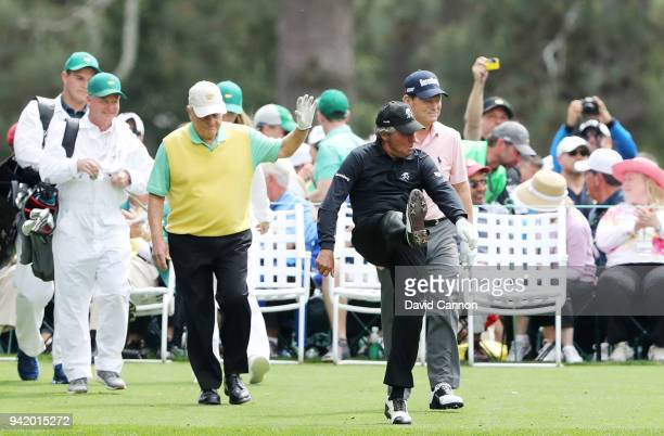 Gary Player of South Africa celebrates as he walks off a tee with Jack Nicklaus of the United States and Tom Watson of the United States during the...