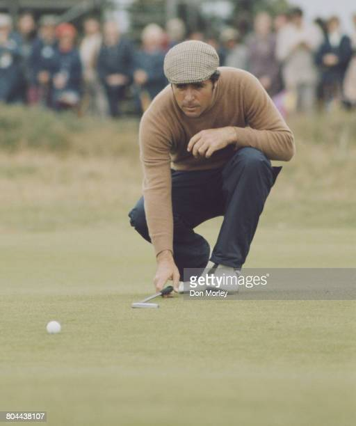Gary Player of South Africa checks the lay of his golf ball before putting during the 103rd Open Championship on 13 July 1974 at the Royal Lytham St...