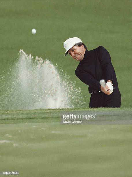 Gary Player of South Africa chips out of the sand bunker on 12th April 1984 during the US Masters Golf Tournament at the Augusta National Golf Club...
