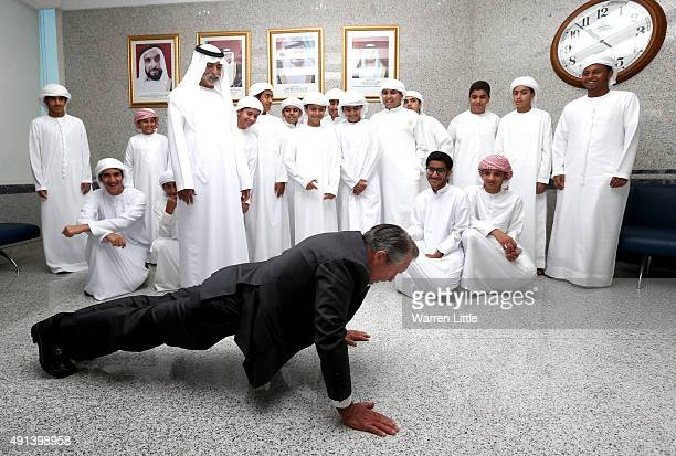 Gary Player of South Africa gives His Excellency Sheikh Nahyan Bin Mubarak Al Nahyan and a group of youngsters a fitness example at the launch of the...