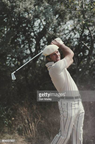Gary Player of South Africa hits an iron shot on during the 105th Open Championship on 10 July 1976 at the Royal Birkdale Golf Club in Southport...