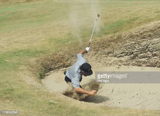 Gary Player of South Africa hits his ball out of the bunker as spectators look on during the Senior Open Championshipon 23 July 1994 at the Royal...