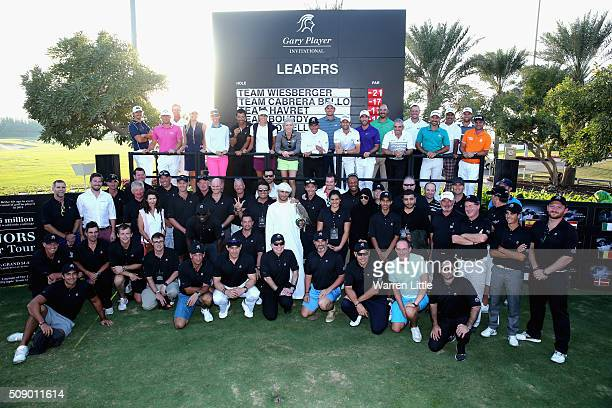 Gary Player of South Africa is joined by professional and amateur competitors after the Gary Player Invitational Abu Dhabi at Saadiyat Beach Golf...