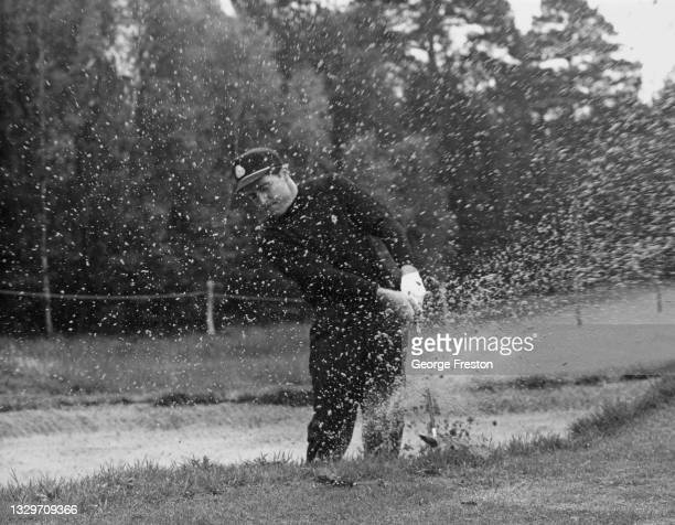Gary Player of South Africa plays an iron shot out of the sand bunker during a practice round for the Piccadilly World Match Play Championship golf...