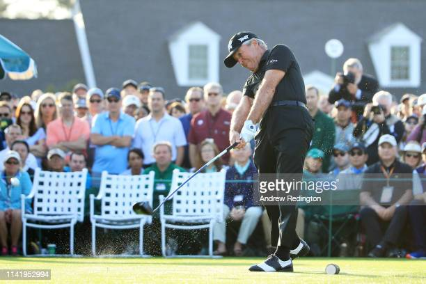 Gary Player of South Africa plays his shot from the first tee during the First Tee ceremony to start the first round of the Masters at Augusta...
