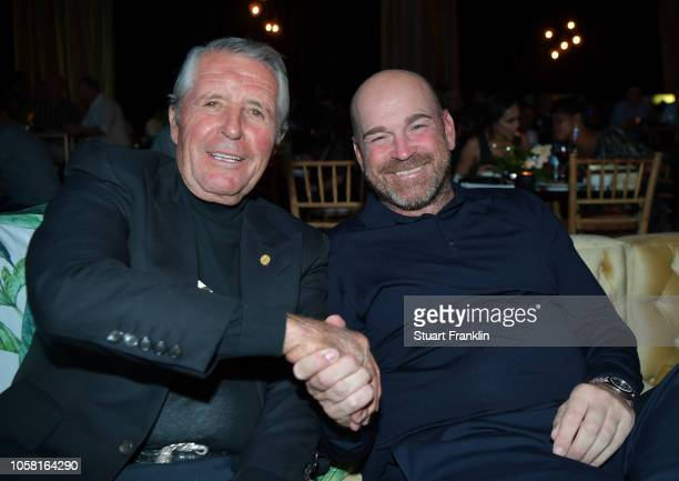 Gary Player of South Africa shakes hands with Thomas Bjorn of Denmark at the gala dinner prior to the start of the Nedbank Golf Challenge at Gary...