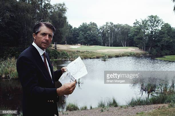 Gary Player of South Africa stands with the plans to the Edinburgh Course at the Wentworth Club, which he helped to co-design at Virginia Water,...