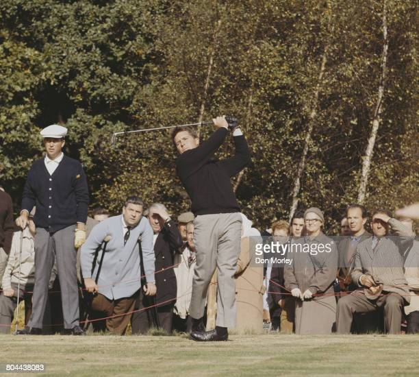 Gary Player of South Africa tees off as Ken Venturi of the United States and the spectators look on during the first Piccadilly World Match Play...