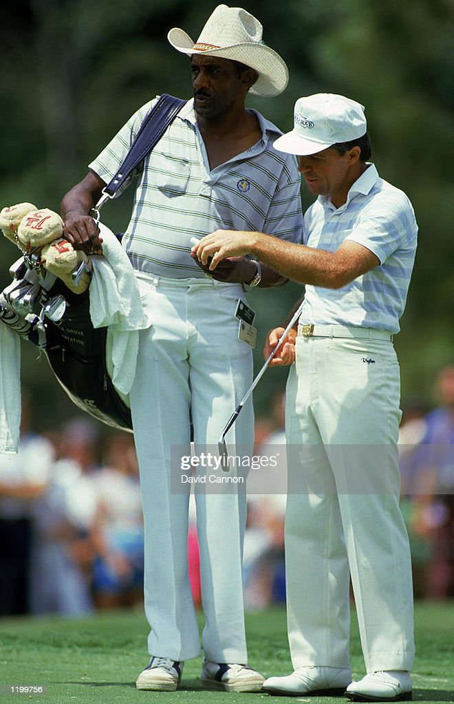Gary Player of South Africa with caddie Alfred 'Rabbit' Dyer during the USPGA Championship at Shoal Creek in Birmingham, Alabama, USA in August 1984.
