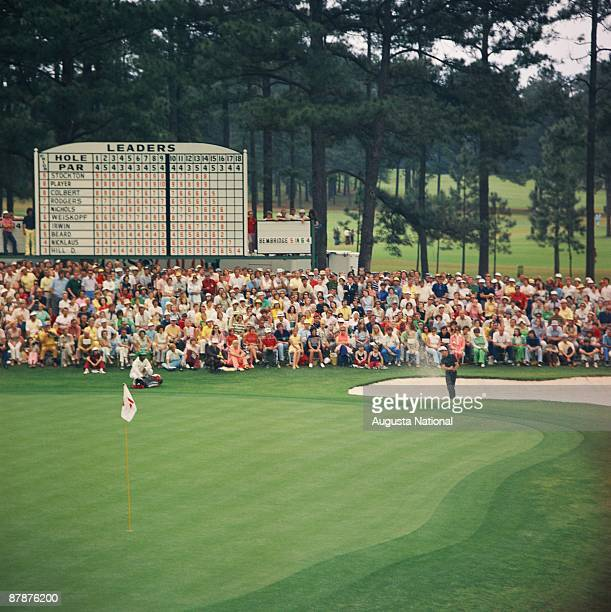 Gary Player pitches out of a bunker on the 15th hole during the 1974 Masters Tournament at Augusta National Golf Club in April 1974 in Augusta Georgia