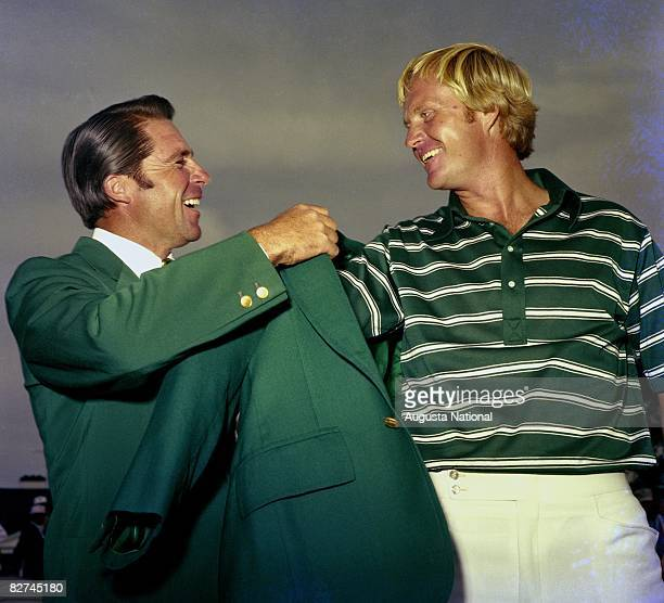 Gary Player presents the Green Jacket to Jack Nicklaus at the Presenataion Ceremony during the 1975 Masters Tournament at Augusta National Golf Club...