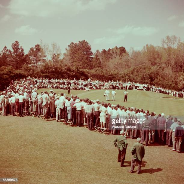 Gary Player putts on the fifth hole during a playoff with Arnold Palmer and Dow Finsterwald during the 1962 Masters Tournament at Augusta National...