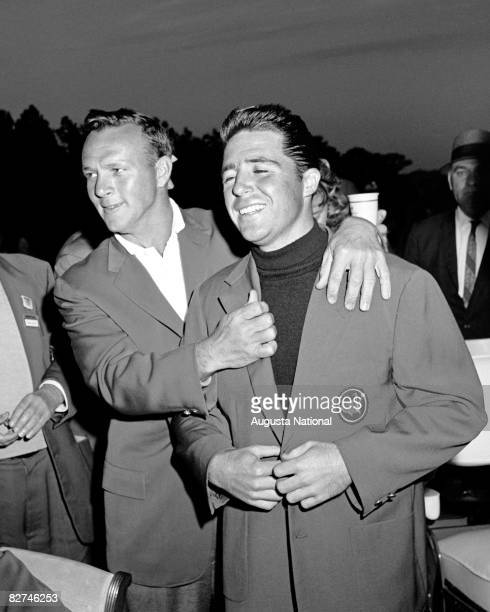 Gary Player receives his first green jacket from Arnold Palmer during the Presentation Ceremony at the 1961 Masters Tournament at Augusta National...