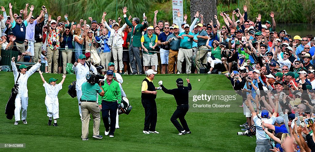 Gary Player, right, and the gallery react to his hole-in-one from