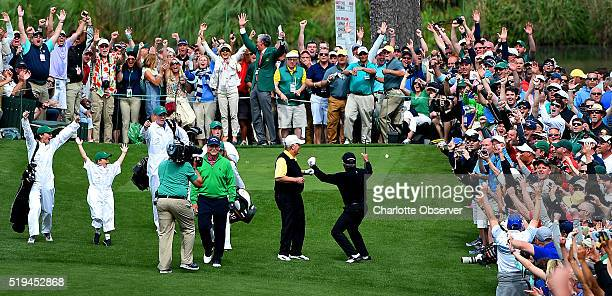 Gary Player, right, and the gallery react to his hole-in-one from the seventh tee box during the Par 3 contest on Wednesday, April 6 at Augusta...