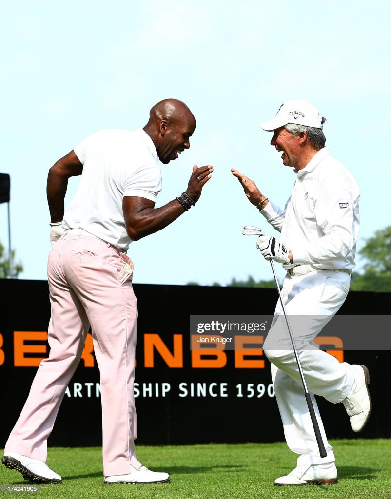 Gary Player shares a joke with DJ Spoony during the Gary Player Invitational Europe 2013 at Wentworth Golf Club on July 22, 2013 in Virginia Water, England.