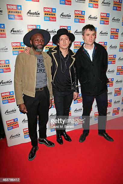 Gary Powell Carl Barat and John Hassall of The Libertines arrive at the NME Awards at Brixton Academy on February 18 2015 in London England
