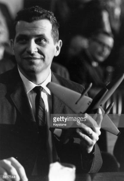 Gary Powers the American spy pilot shot down over Russia with a model of the U 2 spy plane at a Senate Armed Forces Committee in Washington