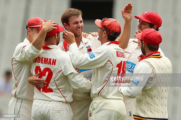 Gary Putland of the Redbacks is congratulated by team mates after getting the wicket of Louis Cameron of the Bushrangers during day four of the...