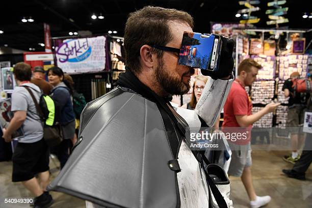 Gary Reynolds looks at a virtual reality comic book through cardboard VR googles designed by students at the Rocky Mountain College of Art and Design...