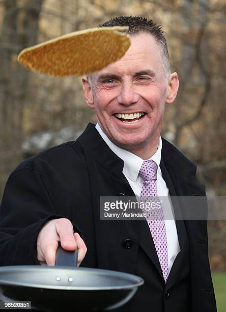 Gary Rhodes flipping pancakes at a photocall for the annual charity Parliamentary Pancake Race at Victoria Tower Gardens on February 9 2010 in London...