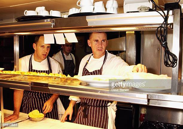 Gary Rhodes prepares the food for the opening of his Restaurant 24 on the twenty fourth floor of the Old Nat West Building on October 17 2003 in...