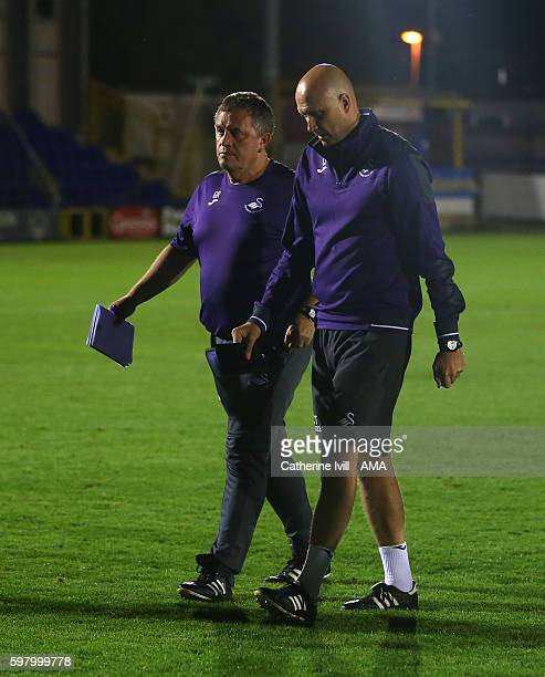 Gary Richards and Cameron Toshack coaches for Swansea City during the Checkatradecom Trophy match between AFC Wimbledon and Swansea City at The...