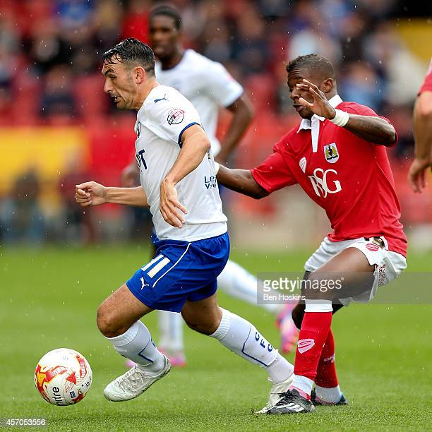 Gary Roberts of Chesterfield holds off pressure from Kieran Agard of Bristol during the Sky Bet League One match between Bristol City and...