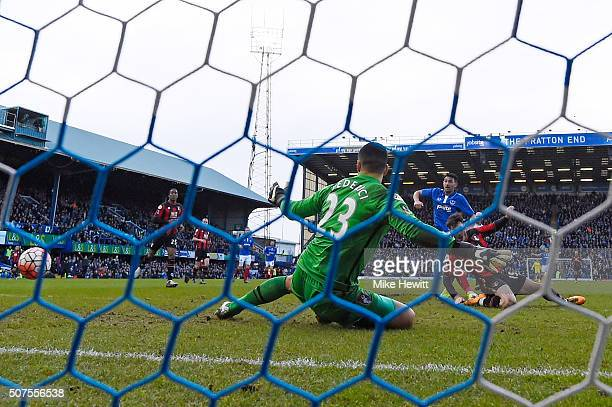 Gary Roberts of Portsmouth scores his team's first goal past Adam Federici of Bournemouth during the Emirates FA Cup Fourth Round match between...