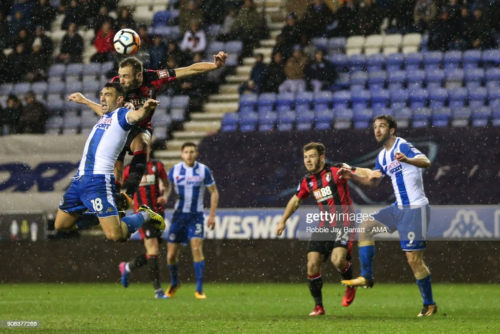Gary Roberts of Wigan Athletic and Steve Cook of Bournemouth during The Emirates FA Cup Third Round Replay between Wigan Athletic v AFC Bournemouth at DW Stadium on January 17, 2018 in Wigan, England.