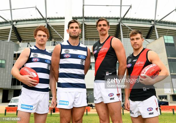 Gary Rohan and Tom Hawkins of the Cats pose with Joe Daniher and Zach Merrett of the Bombers during an Essendon Bombers Powercor Country Festival at...