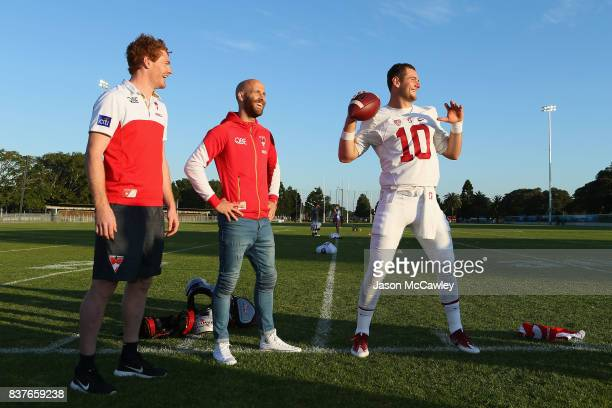 Gary Rohan Jarrad McVeigh of the Sydney Swans and Kaeller Chryst of Stanford University during a US College Football Media Opportunity at Tramway...