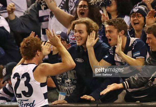 Gary Rohan of the Cats celebrates after kicking a goal with supporters in the crowd during the round 16 AFL match between the Western Bulldogs and...