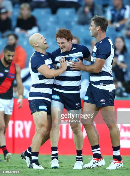 Gary Rohan of the Cats is congratulated by Gary Ablett of the Cats and Tom Hawkins of the Cats after kicking a goal during the 2019 JLT Community...