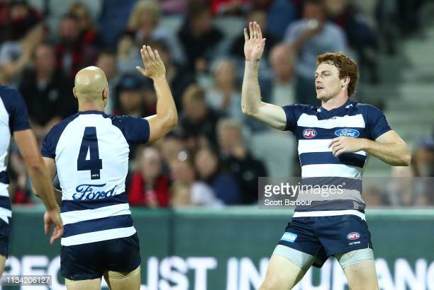 Gary Rohan of the Cats is congratulated by Gary Ablett of the Cats after kicking a goal during the 2019 JLT Community Series AFL match between the...