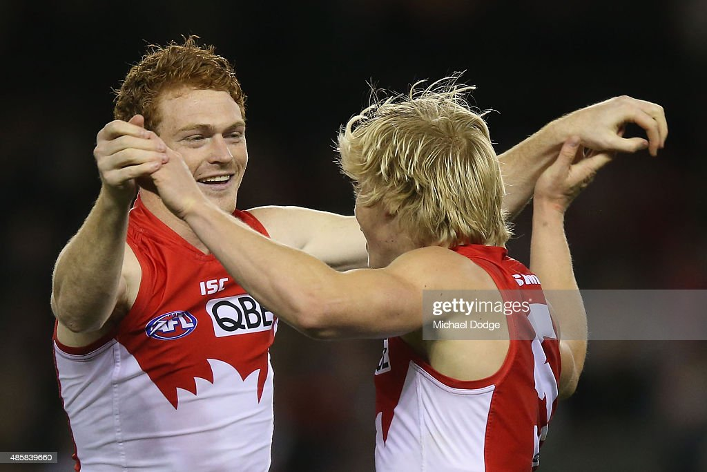 Gary Rohan of the Swans and Isacc Heeney (R) celebrates a goal during the round 22 AFL match between the St Kilda Saints and the Sydney Swans at Etihad Stadium on August 30, 2015 in Melbourne, Australia.