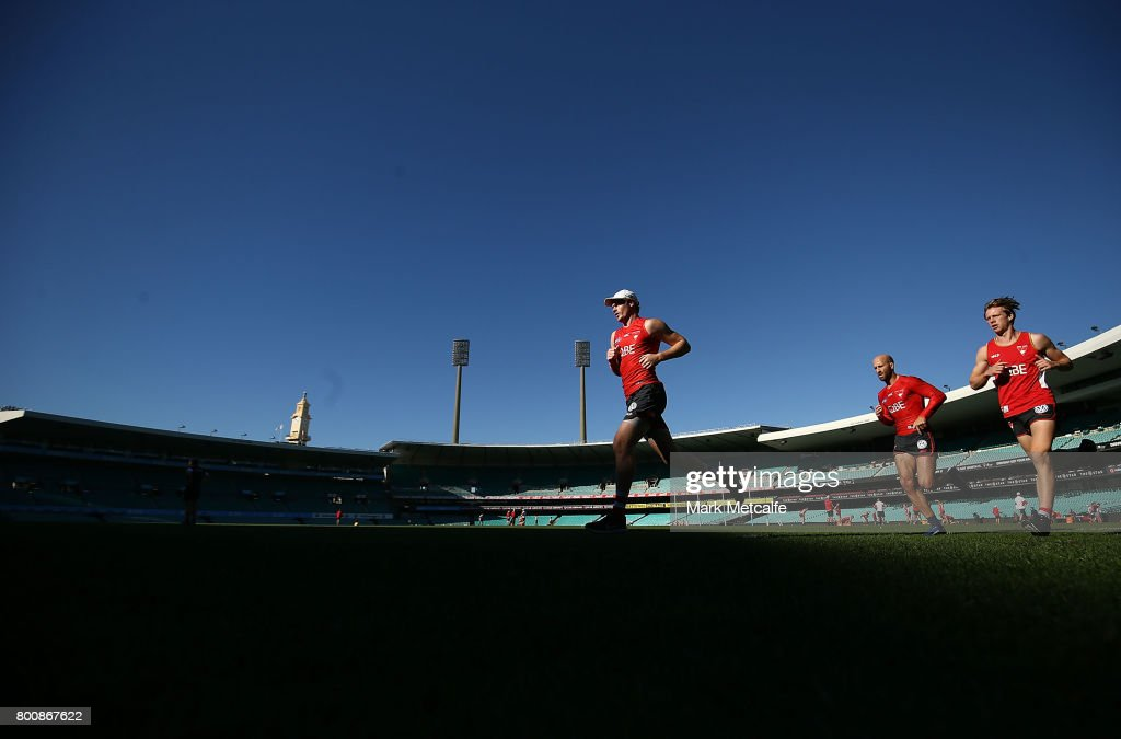 Gary Rohan of the Swans and Jarrad McVeigh of the Swans run during a Sydney Swans AFL training session at Sydney Cricket Ground on June 26, 2017 in Sydney, Australia.