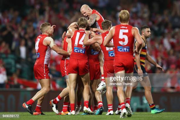Gary Rohan of the Swans celebrates kicking a goal with team mates during the round five AFL match between the Sydney Swans and the Adelaide Crows at...