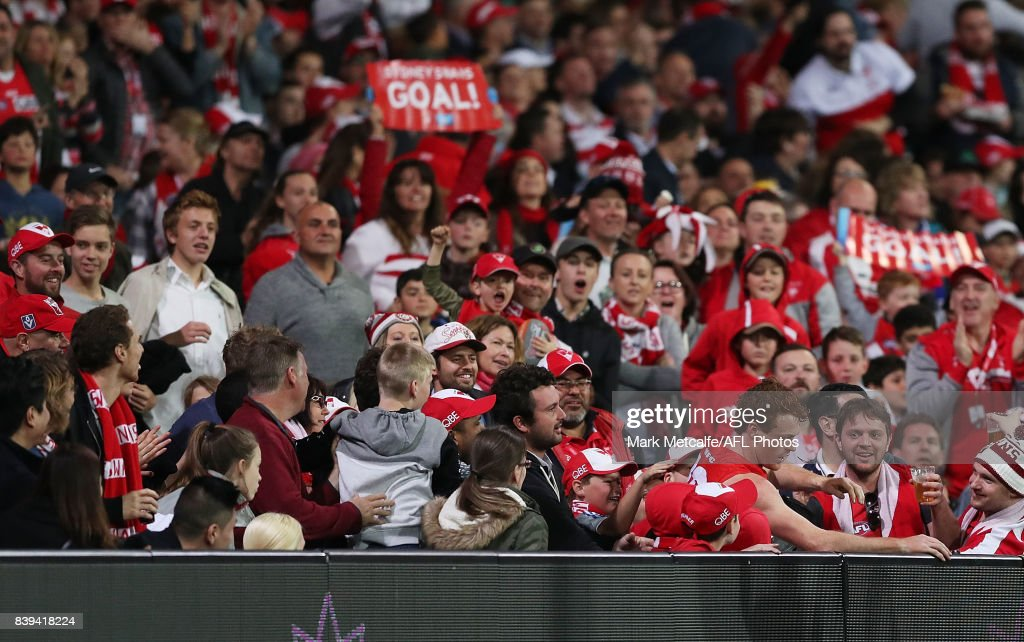 Gary Rohan of the Swans emerges from the crowd after kicking a goal during the round 23 AFL match between the Sydney Swans and the Carlton Blues at Sydney Cricket Ground on August 26, 2017 in Sydney, Australia.