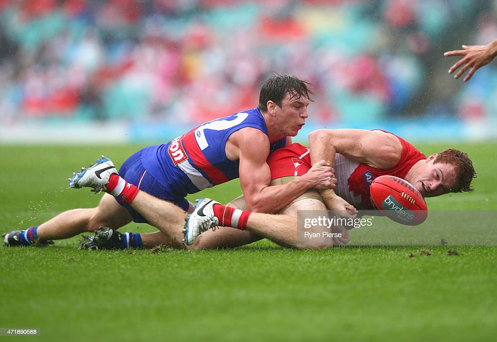 Gary Rohan of the Swans is tackled by Liam Picken of the Bulldogs during the round five AFL match between the Sydney Swans and the Western Bulldogs at SCG on May 2, 2015 in Sydney, Australia.