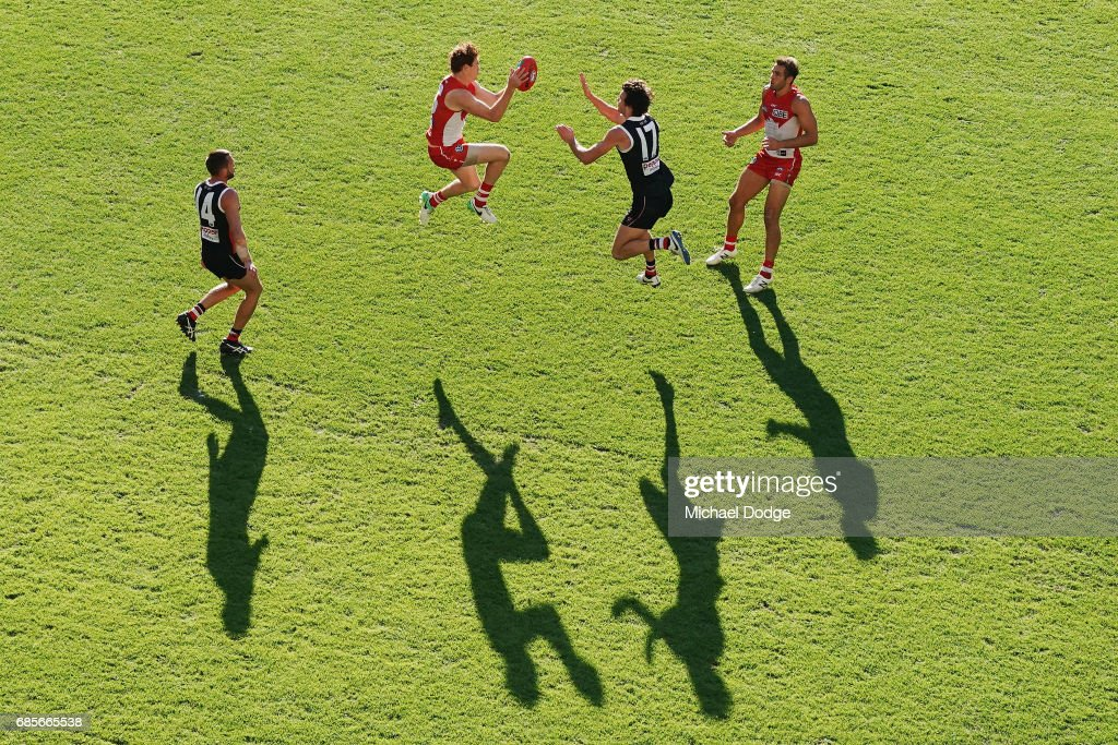 Gary Rohan of the Swans marks the ball against Dylan Roberton of the Saints during the round nine AFL match between the St Kilda Saints and the Sydney Swans at Etihad Stadium on May 20, 2017 in Melbourne, Australia.