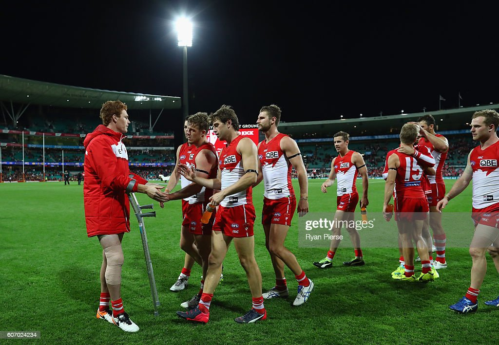 Gary Rohan of the Swans speaks to his team mates at the end of the match after injuring his leg during the First AFL Semi Final match between the Sydney Swans and the Adelaide Crows at the Sydney Cricket Ground on September 17, 2016 in Sydney, Australia.