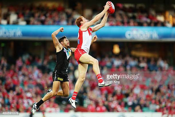 Gary Rohan of the Swans takes a mark over Jarman Impey of the Power during the round 13 AFL match between the Sydney Swans and the Port Adelaide...