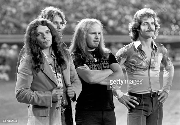 Gary Rossington Steve Gaines and Ronnie Van Zant of Lynyrd Skynyrd and Freddie Weller on the field before the Season Opening Atlanta Braves Game...