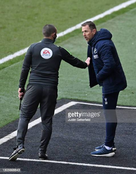 Gary Rowett, Manager of Millwall FC talks to Fourth official Scott Tallis during the Sky Bet Championship match between Millwall and Blackburn Rovers...