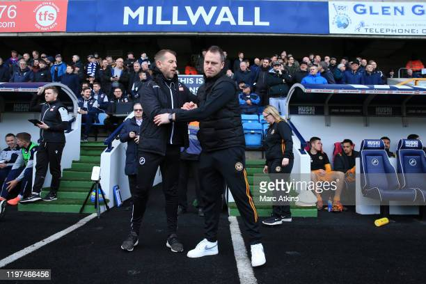 Gary Rowett, Manager of Millwall shakes hands with Michael Flynn, Manager of Newport County prior to the FA Cup Third Round match between Millwall FC...